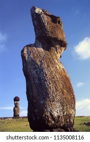 Ahu Tahai with two moai statues one distant moai with top knot, Easter Island, Chile