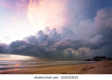 Ahungalla Beach, Sri Lanka, Asia - Illuminated clouds and light during sunset at the beach of Ahungalla