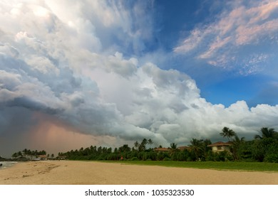 Ahungalla Beach, Sri Lanka, Asia - Huge clouds and various light during sunset at the beach of Ahungalla