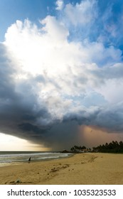 Ahungalla Beach, Sri Lanka, Asia - Enormous clouds and backlight during sunset at the beach of Ahungalla