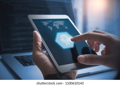 AI, Artificial Intelligence, Big data, Internet of Things IoT. Man using digital by id touch, big data and deep learning, coding on laptop computer with futuristic technology background