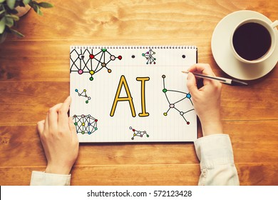 AI text with a person holding a pen on a wooden desk