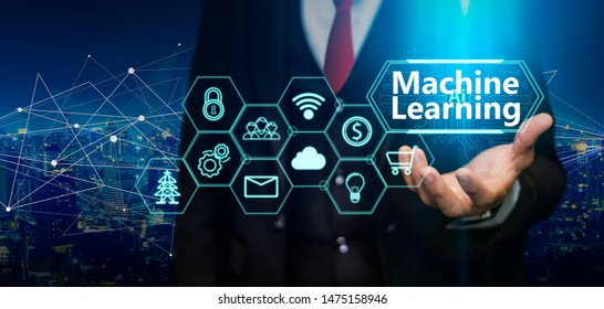 AI(Artificial Intelligence) and machine learning concept. Business person hold machine learning illustration and icon technology.5G network wireless systems.IoT(Internet of Things), ICT concept.