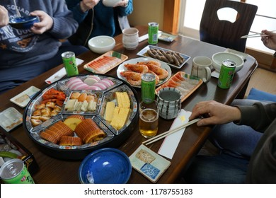 AICHI, JAPAN - January 1, 2018: A Japanese family enjoying a traditional New Years feast, also known as Osechi-ryori.