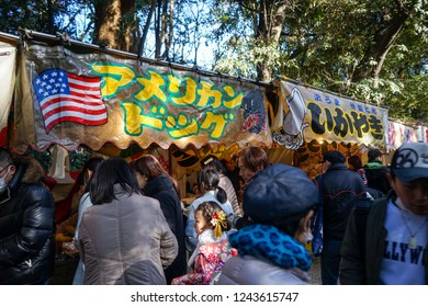 AICHI, JAPAN - JANUARY 2, 2018: People lining up to purchase from Yatai, concession stands, at the Atsuta Shrine as they come to visit for Hatsumoude, the first shrine visit of the year.