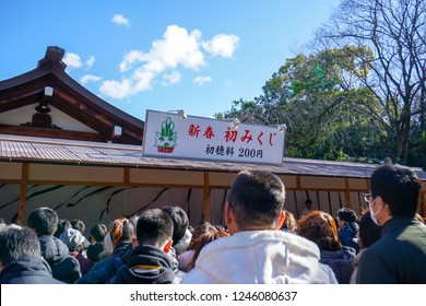 AICHI, JAPAN - January 2, 2018: People flocking to Atsuta Shrine for the first shrine visit of the year (Hatsumoude) and heading to buy fortune-telling paper strips (Omikuji) from the booth.