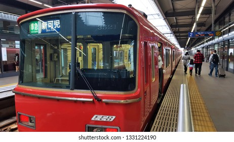 Aichi, JP - OCTOBER 3, 2017: The vintage classic red local train that stopping for tourists at Chubu International Airport railway station on Meitetsu Line in Nagoya District.