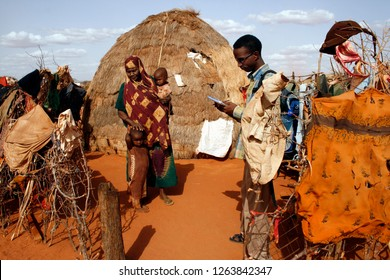 An aid worker collects health and (mal)nutrition data during a field visit in Mandera, northeastern Kenya. July 2009. Malnutrition is a big problem among children under 5 in this arid border town.