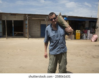 Aid worker or missionary carrying food aid in Africa