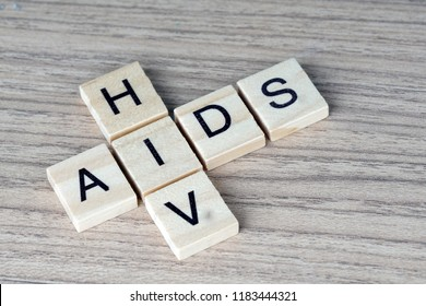 AIDS/HIV word on a wooden table .Aids / HIV Concept. healthcare and medical concept.