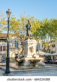 AIGUES-MORTES, FRANCE - APRIL 11 : Statue of Saint Louis at center square of Aigues-Mortes city in France, under blue sky, on April 11, 2017.