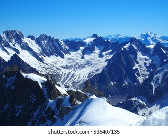 AIGUILLE du MIDI alpine mountains range in beauty French, Italian and Swiss snow covered ALPS landscape in CHAMONIX MONT BLANC with clear blue sky in warm sunny summer day, FRANCE / EUROPE - JULY 2016