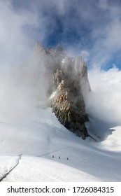 Aiguille du Midi in the fog and clouds in the French Alps, Chamonix Mont-Blanc, France