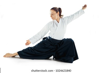 Aikido master practices defense posture. Healthy lifestyle and sports concept. Woman in white kimono on white background. Karate woman with concentrated face in uniform.