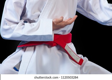 Aikido red belt on white kimono on black background
