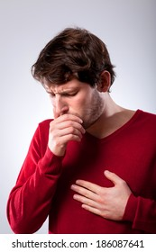 Ailing young man suffering from pneumonia, vertical
