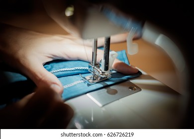 ailoring Process - Women's hands behind her sewing