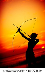 Aiming at goal archer sunset