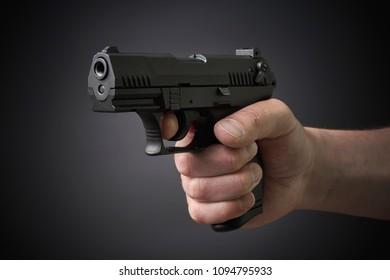 aiming with a handgun