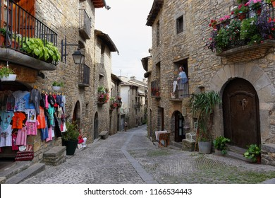 Ainsa, Spain - July 21, 2018: Ainsa medieval village of the Pyrenees with beautiful stone houses in Huesca, Spain