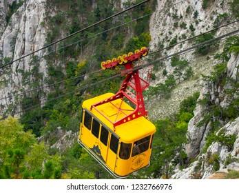 AI-Petri mountain near Yalta (Crimea, Russia) September 28, 2018: funicular with passengers moving on the slope