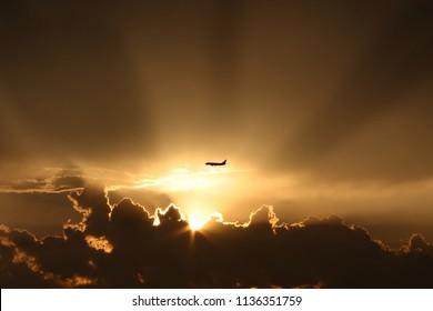 Aiplane landing during sunset