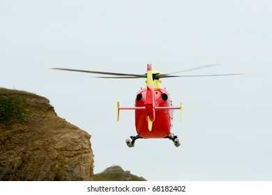 Air ambulance flying near to cliffs as it prepares to land during emergency flight