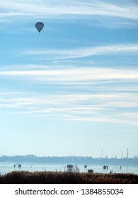Air balloon over Mihailesti lake, Romania. Mihailesti is a dam lake near Bucharest, built on Argeș river.