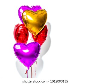 Air Balloons. Bunch of colorful heart shaped foil balloons isolated on white background. Love. Holiday celebration. Valentine's Day party decoration