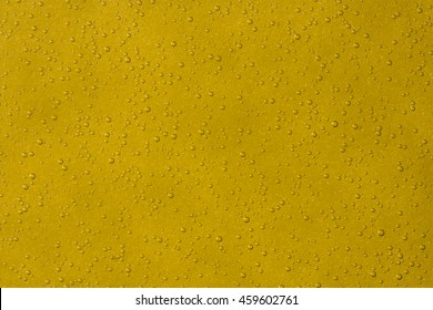 Air bubbles in beer on a yellow background. texture. refresher.