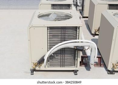 Air compressor machine on concrete floor.