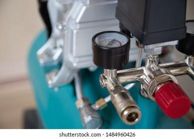 Air compressor pressure pump closeup photo with selective focus on an emergency shutdown valve.