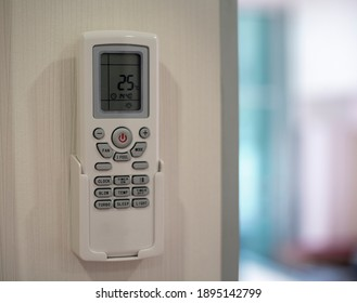 Air condetioner remote control hanging on the wall