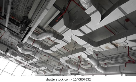 Air condition and hvac system installation under bareskin ceiling before interior finishing.