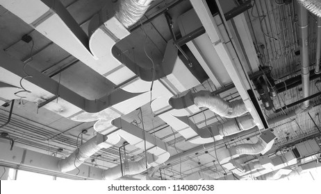 Air condition and hvac system installation under bareskin ceiling before interior finishing. Shoot in black and white shot.