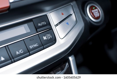 Air conditioner button for on/off speed air flow and automatic temperature button in a luxury car.