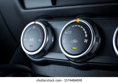 Air conditioner button for speed airflow adjustment in a luxury car.