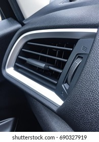 Air Conditioner in car and switch on/off compartment.