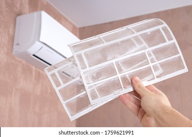 air conditioner cleaning. dirty ac filter. indoors. cleaning and maintenance service concept. two wet and clean filters of aircon.