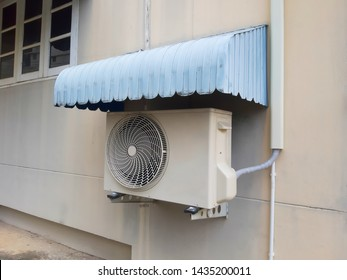 Air conditioner compressor   installed outside the building