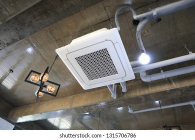 Air conditioner installed on ceiling of cafe