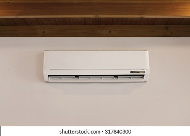 Air conditioner machine on off-white wall