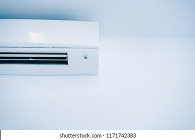 Air conditioner in the office room,with copy space.The cooling system inside the room can be changed to cool the air.Modern technology for temperature adjustment.Electronics,Appliances