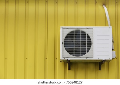 Air conditioner on metal wall, outdoors