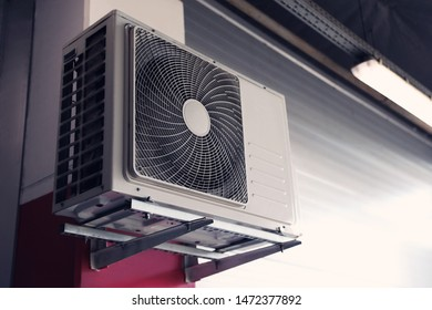 Air conditioner on wall of building. Space for text