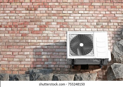 Air conditioner on wall of building, outdoors