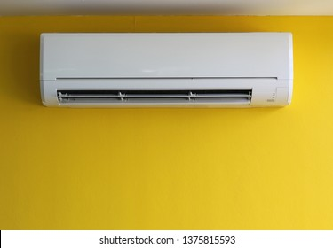 air conditioner on yellow wall
