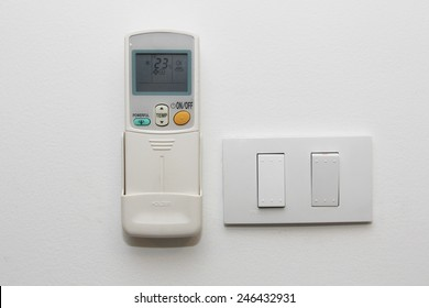 air conditioner remote control on the wall