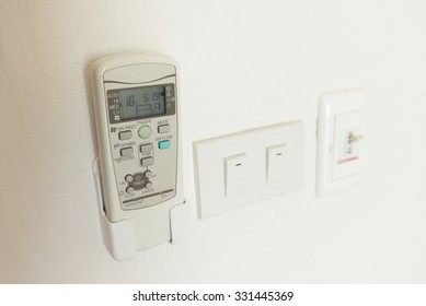 air conditioner remote control on wall.