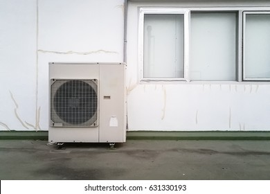 Air conditioner system next to wall. Fan box outdoors. Nobody